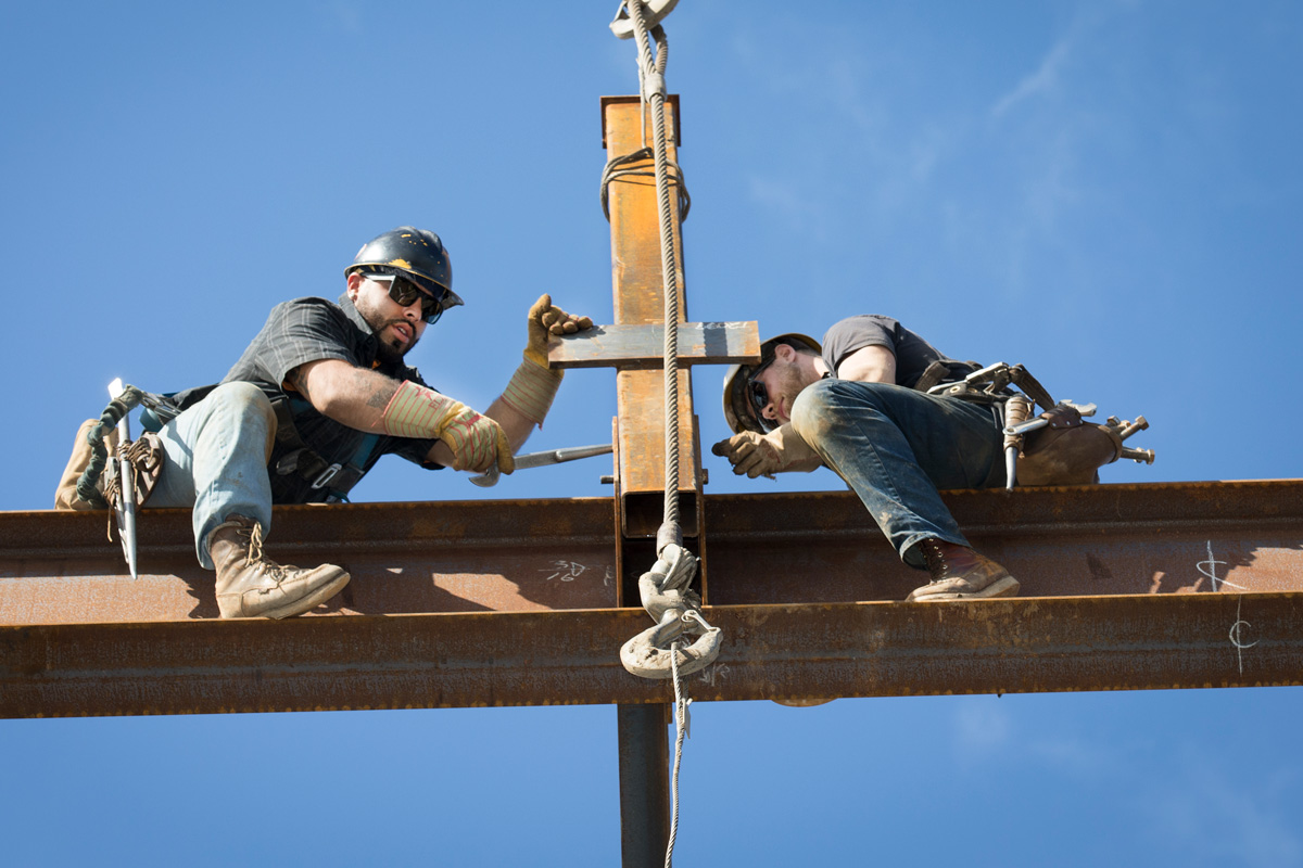 Steel workers on construction site in Sunnyvale, California. Photo by Chris Constantine Photography.
