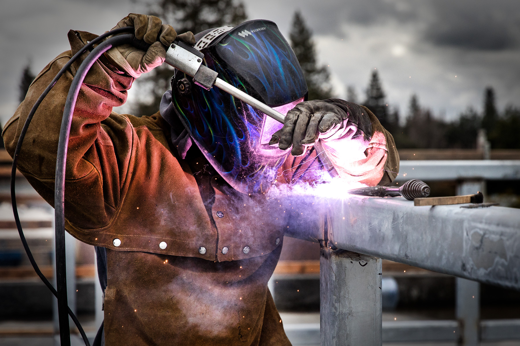 Welder on construction worksite in the San Francisco Bay Area. Photo by Chris Constantine.