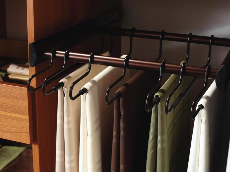 Hanging linen closet rods. Custom product photography by Chris Constantine.