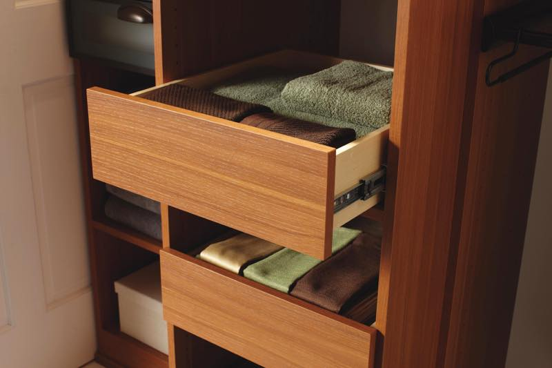 Linen closet pull-out drawers. Detail photography by Chris Constantine.